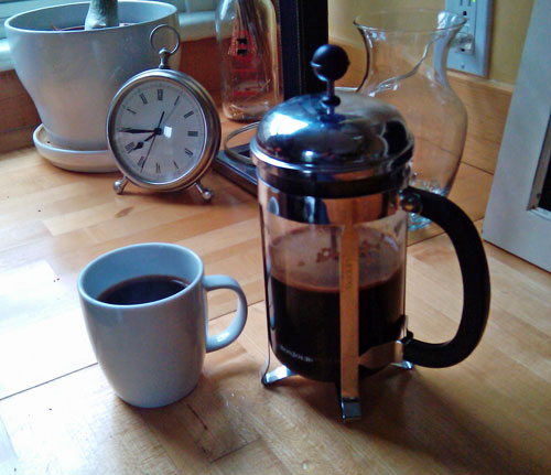 French press and clock.