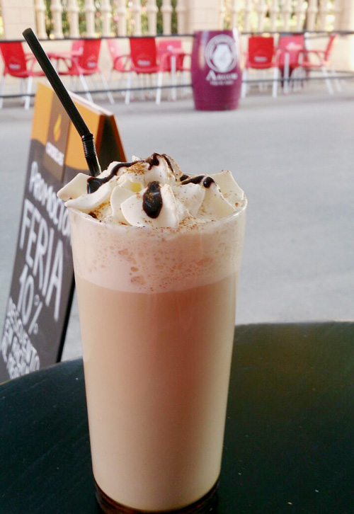 Iced latte in a tall glass.