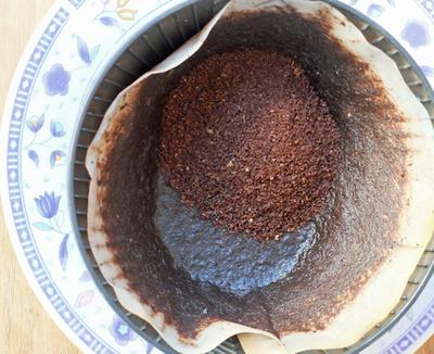 Adding new coffee grounds to coffee that has already been used.