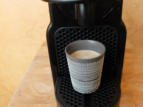 Ceramic espresso cup and Nespresso machine