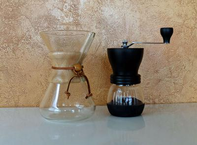 A Chemex brewer and Kyocera hand coffee grinder.