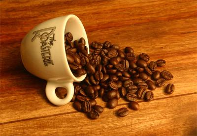 Coffee beans and espresso cup.