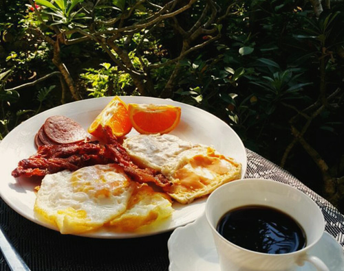 Coffee with bacon and eggs.