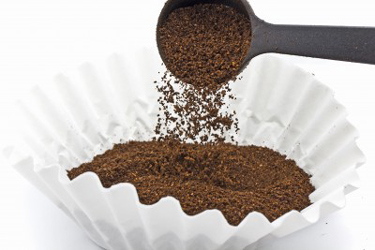 use a coffee scoop or spoon to measure the coffee