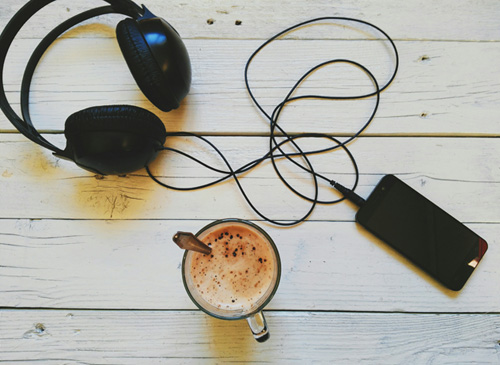 Coffee, headphones and a music player.