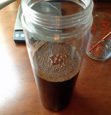 Mix ground coffee and water.