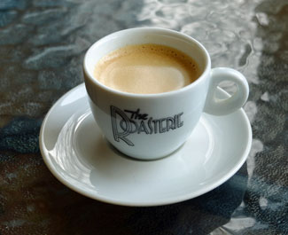 A single shot of espresso, with a nice crema on top.