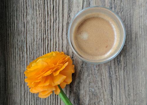 espresso and an orange flower