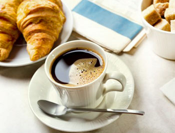 french roast coffee and croissant