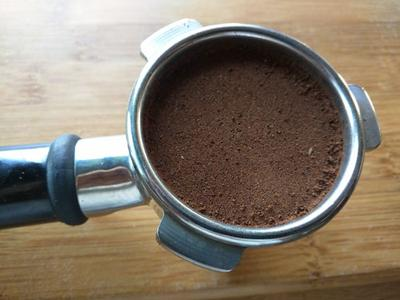 Portafilter packed with coffee grinds of the correct size.