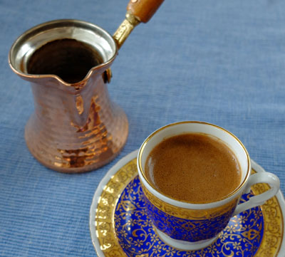 An Ibrik and a demitasse with Turkish coffee.