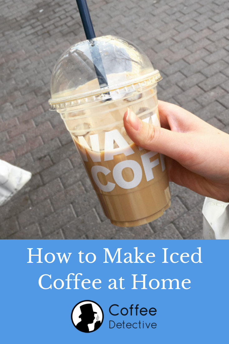 Holding a cup of iced coffee drink