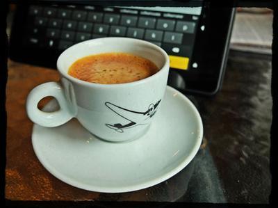 Kindle keyboard and espresso.
