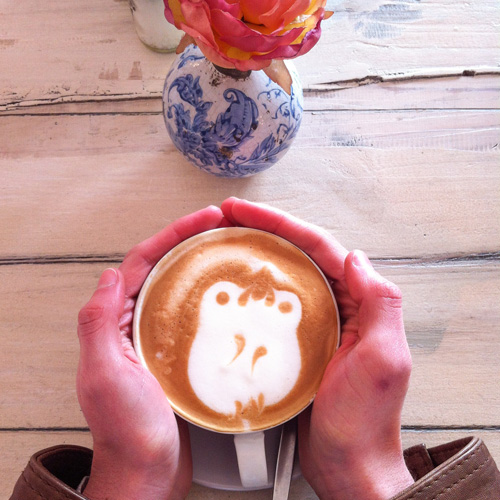 Latte art with hands.