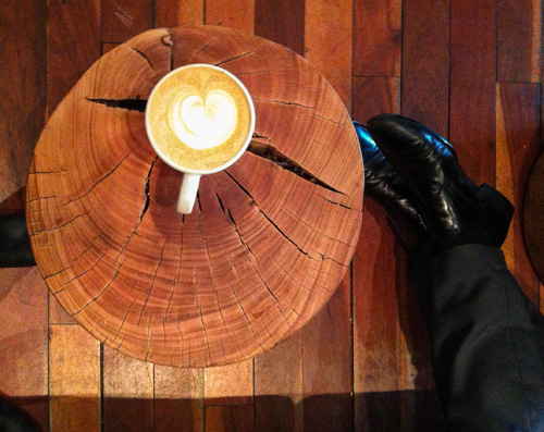 Latte art on wood.
