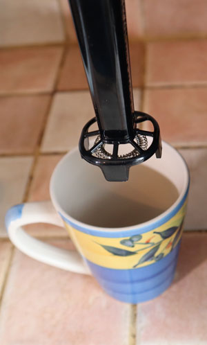 The system comes with a whisk you can use to froth milk for your specialty coffees.