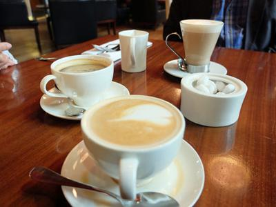 Family brunch with coffees at King's Cross, London.