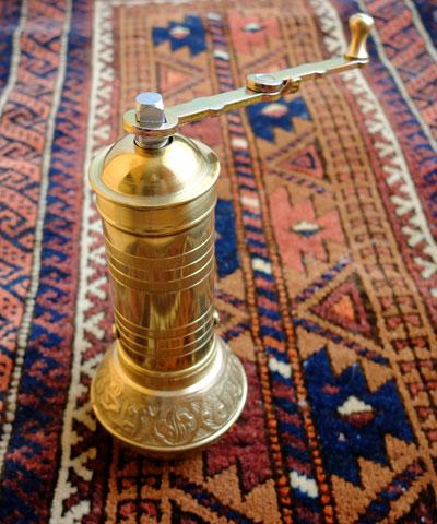 A brass Turkish coffee grinder