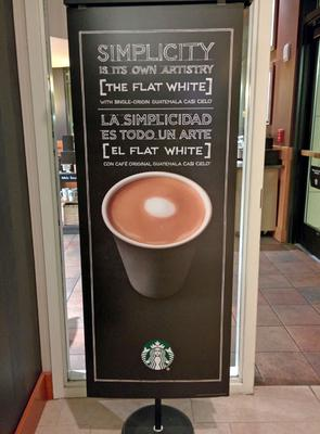 Starbucks signage for Flat White coffee.