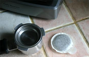 An E.S.E. espresso pod and portafilter.