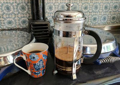 French pressed coffee keeping warm on an old-fashioned stove.