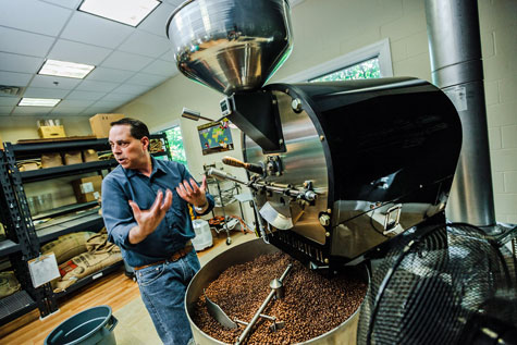 Ed Freedman of Shearwater Organic Coffee Roasters with his small-batch roaster.