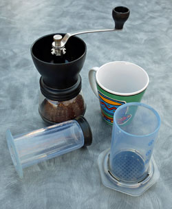 Aeropress brewer and hand coffee grinder