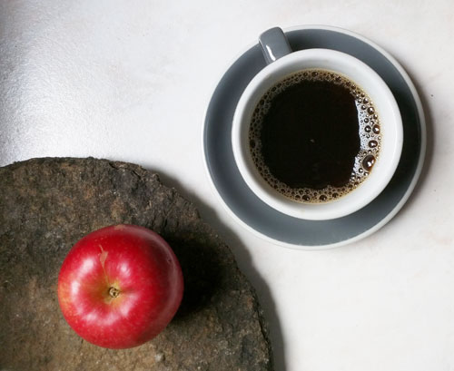 Apple and a cup of coffee