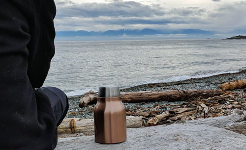 Asobu Cold Brew Insulated Portable Brewer on the beach