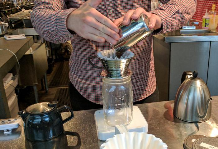 Measuring coffee in an Austin coffee shop
