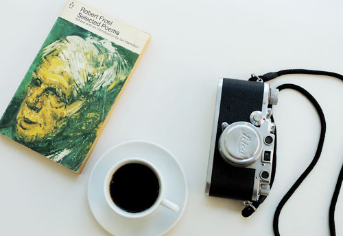 Coffee, book and camera