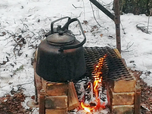 Cowboy coffee making in the snow.