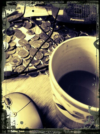 Dirty coffee mug on messy desk