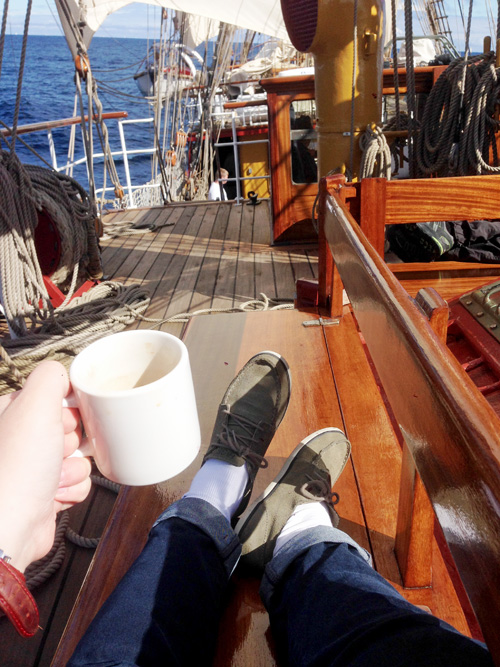 Coffee at sea on a wooden boat.