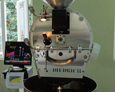 A high-tech coffee roaster, complete with computer and flat-screen monitor.