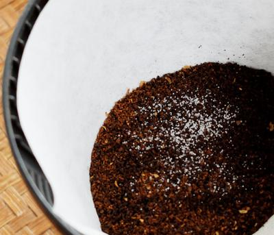 A pinch of salt in your coffee before brewing.