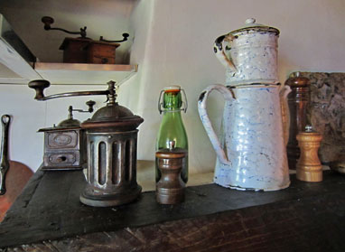 Antique coffee mills and a coffee pot.