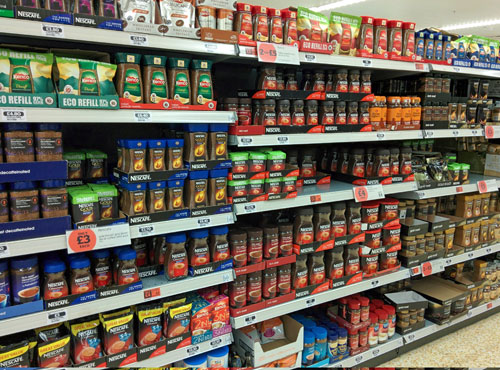 Instant coffee brands on the shelf in a UK supermarket.