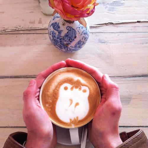 Latte art with hands.