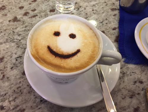 Smiley face on coffee.