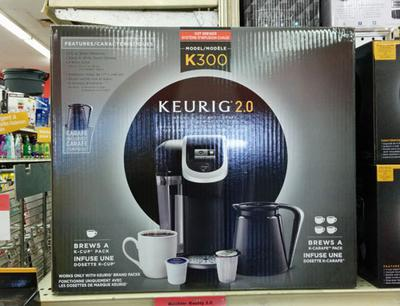 The Keurig 2.0 brewer in its box.