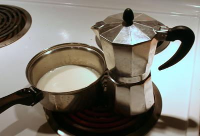 Bialetti and a saucepan of milk.