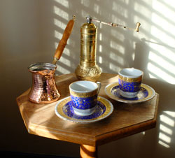 Turkish coffee grinder, ibrik and cups