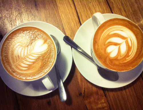 Two lattes on table.